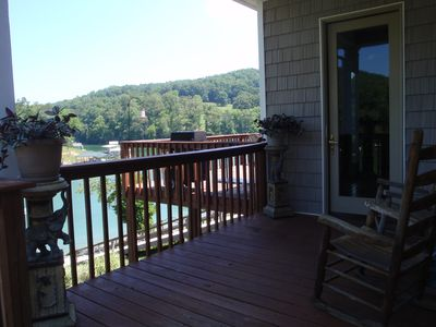 Entry door with rocking chairs and lake view