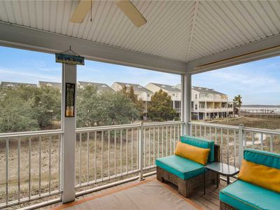 Photo for Beautiful beach condo with marsh and river views and a seasonal community pool.