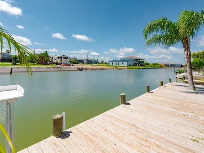 Photo for Canal front getaway with private boat ramp and dock close to Salt Lake and Copano Bay.