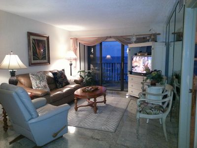 Oceanfront living room with balcony access. 40' smart TV, DVD.
