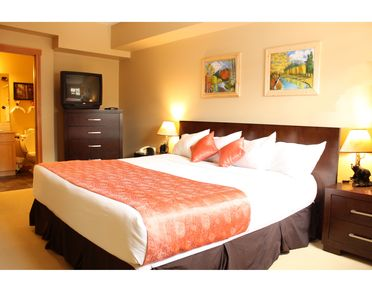 Photo for Cozy 1 Bdrm. quiet side Suite W/ Mtn./Pool View, Indoor Parking, Hot Tubs & BBQ.