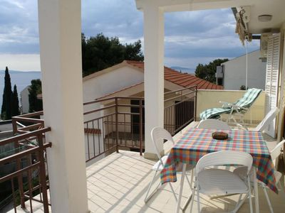 Photo for Two bedroom apartment with terrace and sea view Podgora, Makarska (A-2615-d)
