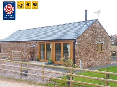 Photo for 4 Star Barn Conversion. WiFi.  Fishing Lake.  Pet and Family Friendly.