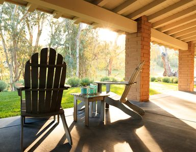 The Adirondack chairs on the porch are a perfect place to unwind.