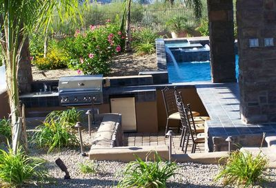 Ramada with outdoor kitchen, swim-up bar which adjoining the swim up bar in pool