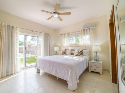 Photo for Contemporary design with lots of big windows, vaulted ceiling and breezy fans await you when you walk into the spacious great room