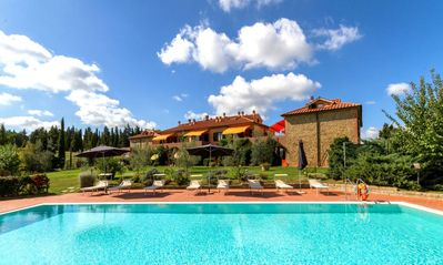 Photo for Lovely apartment with A/C, WIFI, pool, TV, veranda, panoramic view, parking, close to San Gimignano