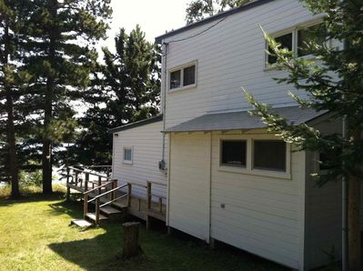 North side of cabin, with side deck and storage.