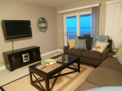 Large Flat Screen-you wont't miss all the action - Living Room view of Gulf.....surely won't distract you...