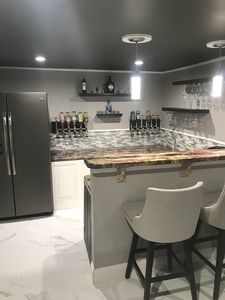 Bar stool, counter and refrigerator - For you to relax and unwind.