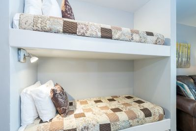 The bunk beds are in between the queen bedroom and the kitchen/living area. Please note, these are small bunk beds so really only good for kids!