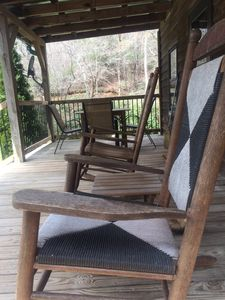 Rocking chairs and table & chairs on the front porch.