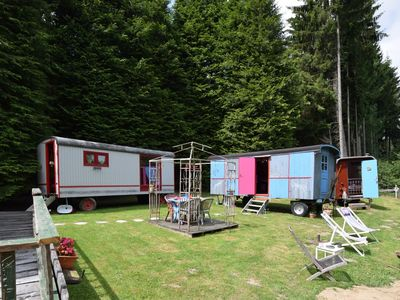 Photo for Small gypsy camp with four colorfully decorated caravans
