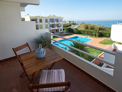 Photo for Apartment with sea view, terrace, swimming pool, near the center and beaches.