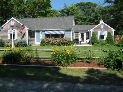 Photo for 5 min walk to Ocean beaches, Cape Cod decor, quiet street, private back yard