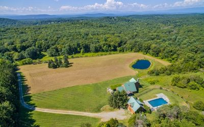Photo for Gorgeous Country Oasis, with pool, pond on a lush 16 acres