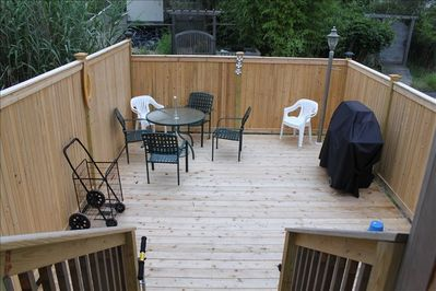 Private front deck with gas barbecue.