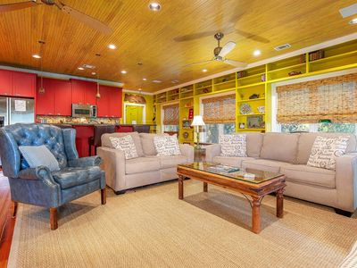 Open Plan Living Room with Sleeper Sofa Large Flat Screen TV