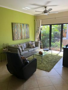 Spacious living room with large flat screen TV and walkout to private yard