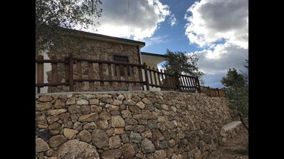 Photo for VILLA in Sardinian stone surrounded by greenery. Panoramic terrace, BBQ and relaxation area