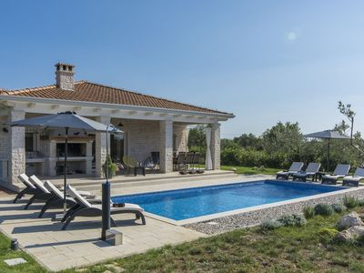 Photo for Spacious Villa for up to 8 persons with private pool, garden, BBQ, A/C