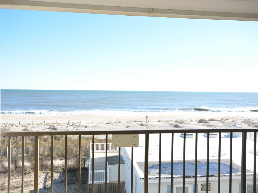 Cozy, comfortable 2 bedroom oceanfront condo with free WiFi, lots of space, and a fabulous view of the ocean located in quiet midtown and mere steps from the beach!