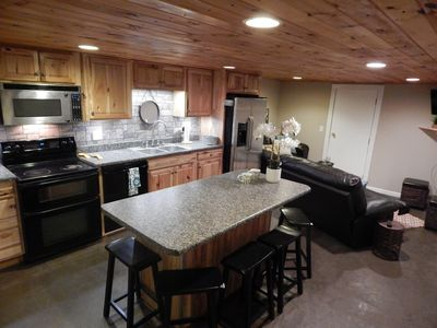 Open kitchen, living, dining area.