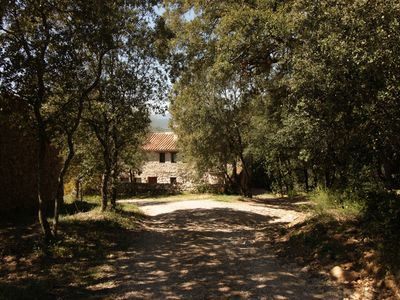 Photo for Rural apartment with garden and pool 5 minutes from the medieval town of Besalú