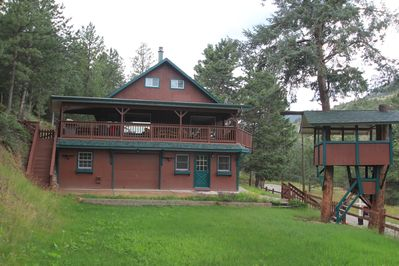 Summit's Gate Home!  Note the covered deck, Treehouse, and field!