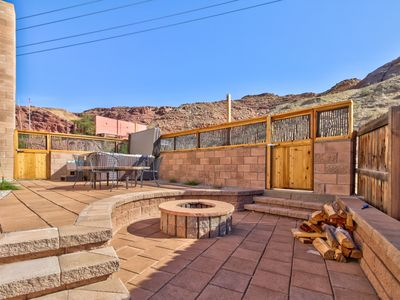 Photo for Spacious condo w/ private hot tub - steps from downtown