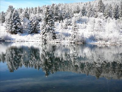 Early season snow reflecting on the ranch pond