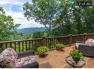 Back deck with long Mountain views.  Great place for dining, lounging & sunsets.