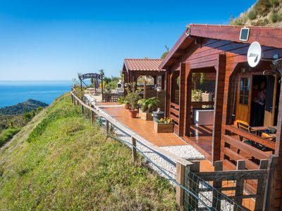 Photo for Idyllic wooden houses with breathtaking sea views.