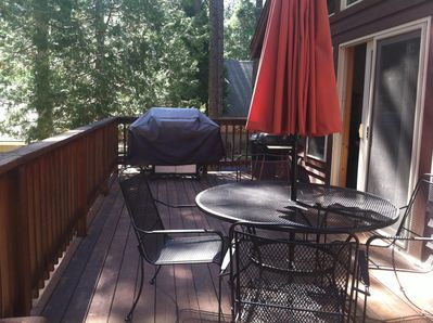 Gas Grill and patio set on the back deck.