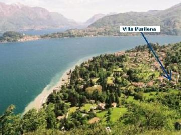 Villa with lake view and garden immersed in the natural park of San Martino