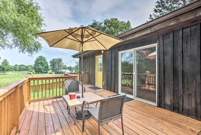 This vacation rental features a furnished deck and grill.