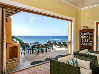 Living room that opens up to the pool deck
