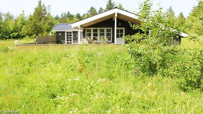 Cozy holiday home with a large natural plot and near the beach
