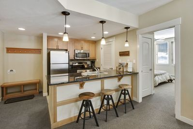 Full size kitchen with seating for 3