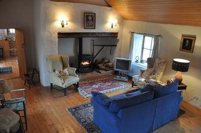The living room - with fire place / wood stove.