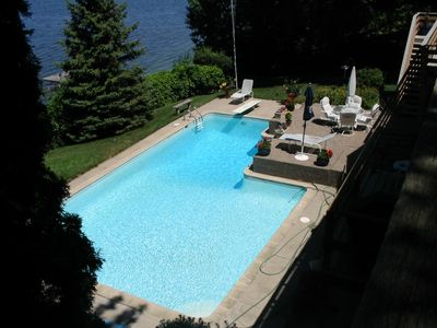 Pool is 40' long with diving board. Deep end is 9' deep & shallow 3-4' deep.