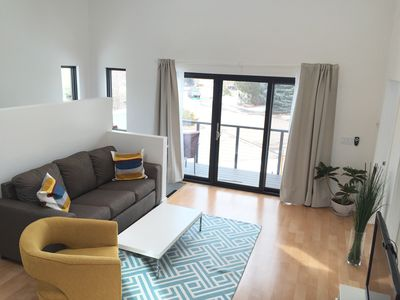 Living Room with door to your private deck. Couch converts to a queen sleeper.