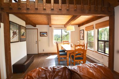 Dining room with views across Alder Creek