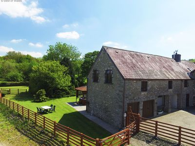Photo for With a hot tub and  on a working farm with stunning views across the river Tywi.