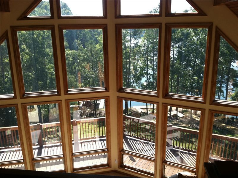 5 br lakefront home large windows hot tub covered for Large windows for homes