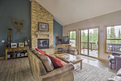 The vacation rental features an open layout and a private, furnished deck.