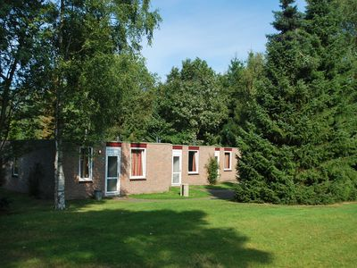 Photo for Single-storey bungalow with fireplace, located on holiday park with a fishing pond