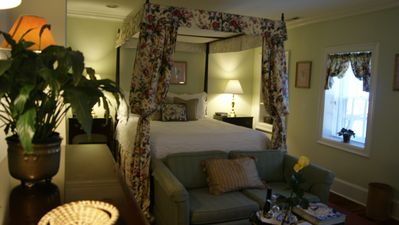 The intimate and romantic bedroom with the four poster bed.