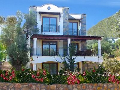 Photo for Quality Holiday Villa with Shared Pool and Sea Views