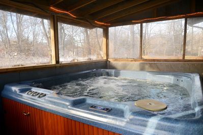 Hot Tub on upper deck. Fully enclosed to use in the winter